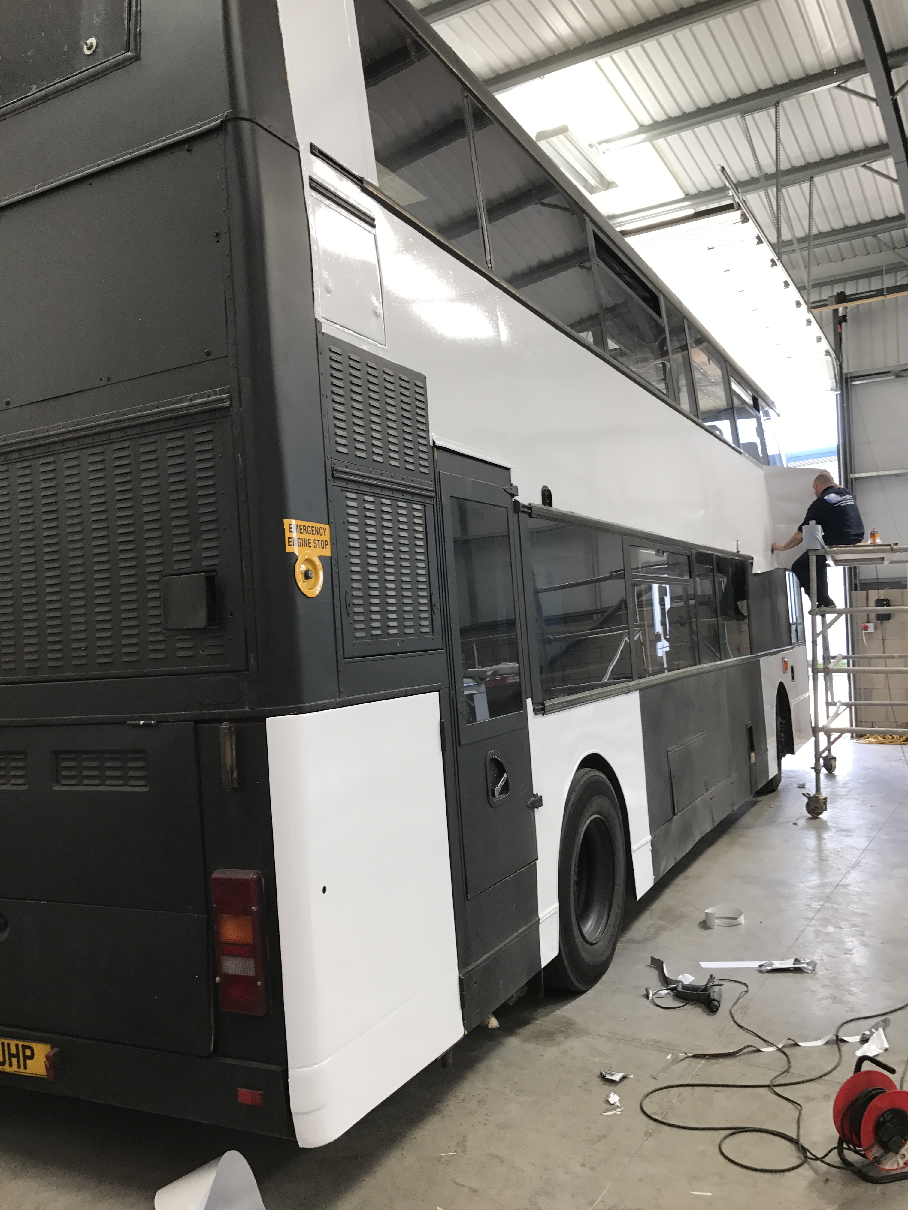 Huge Media Fitter Wrapping a Double Decker
